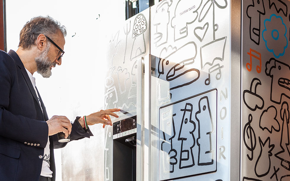 Massimo Bottura looking at Face a Fridge artwork