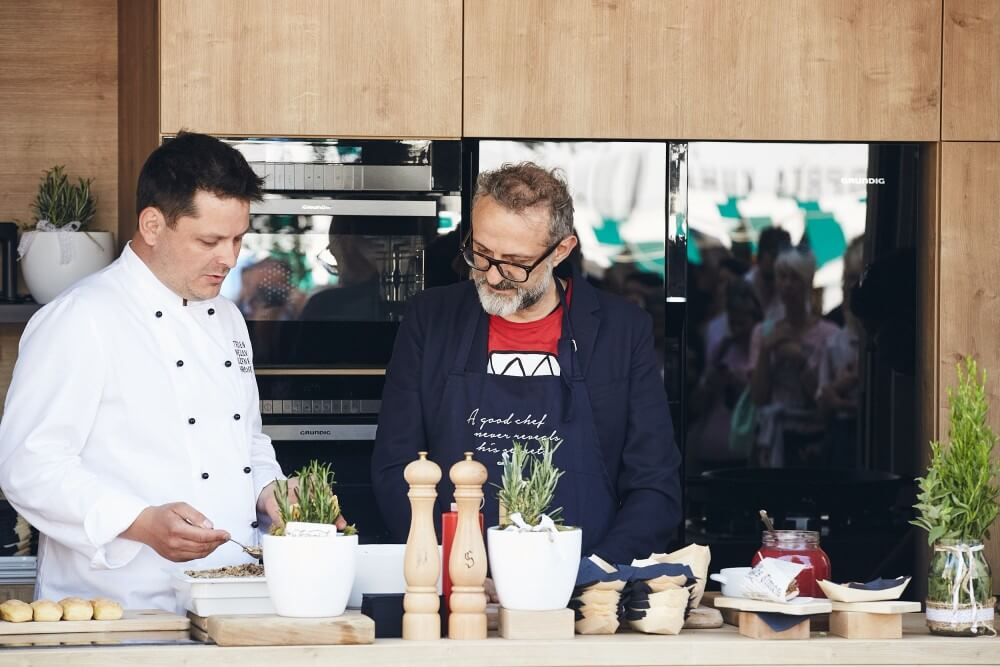 Massimo Bottura participating in the container kitchen