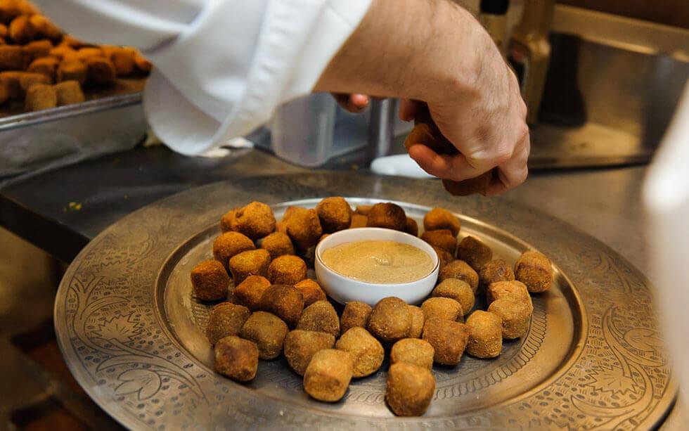 Hands cooking for Refettorio Gastromotiva