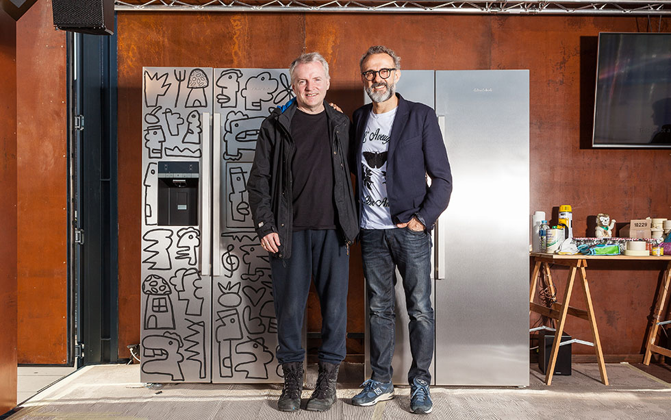 Thierry Noir and Massimo Bottura standing in front of a fridge.